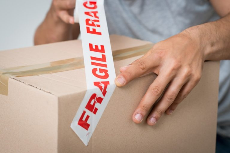 Placing fragile sticker on box