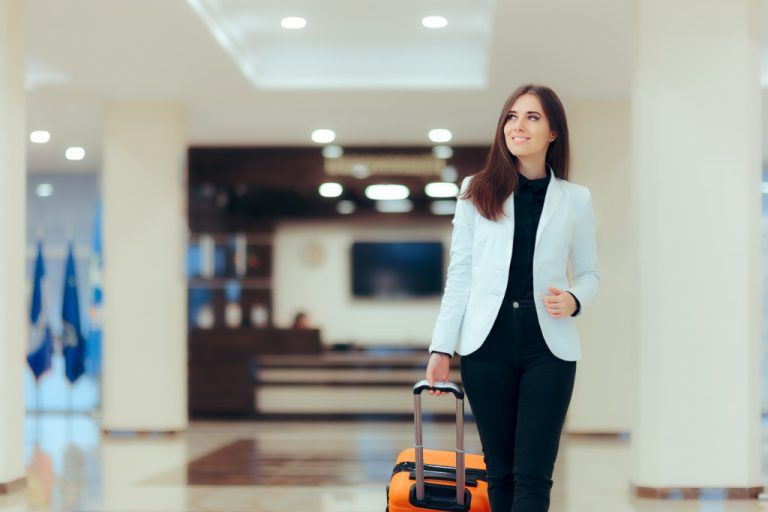 woman going to hotel for staycation