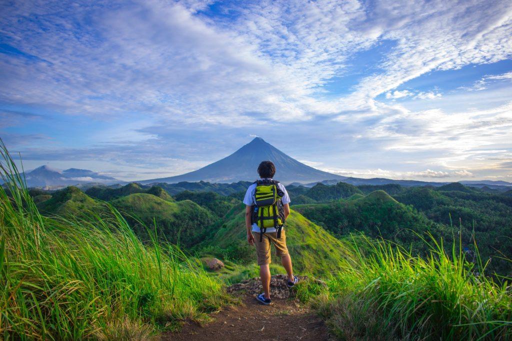 man standing near a mountain
