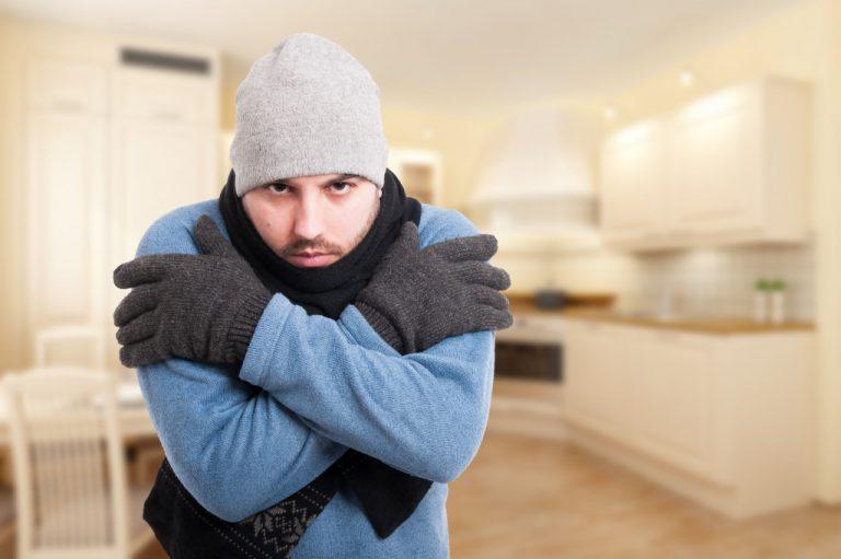 man freezing at home